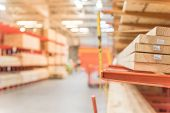 Blurred Close-up Lumber Warehouse At Home Improvement Store poster