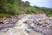 Tropical River Panorama. Tropical Landscape. Fresh River In Stone Riverbed. Tropical Nature In Rain  poster