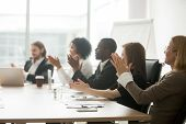 Multiracial Business People Applauding Sitting At Conference Table, Diverse Team Clapping Hands Afte poster