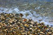 Bright Colorful Stones On The Beach With Clear Clear Water In Mediterranean Sea. Focus Runs Through  poster