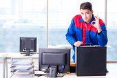 Computer repairman specialist repairing computer desktop poster