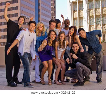 Full Frame Closeup Of Eleven Young Adults Celebrating At Party Outdoors In City