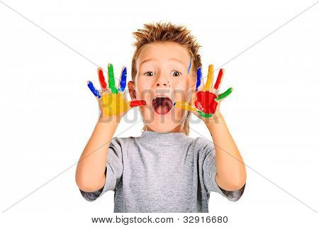 Portrait of an emotional boy enjoying his painting. Education. Isolated over white background.