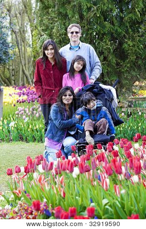 Family With Disabled Boy In The Tulips Gardens