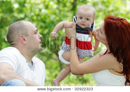 young happy family on natural background