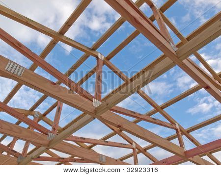 Roof frame construction under cloudy blue sky