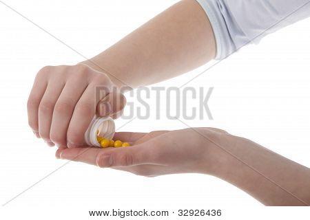 Hands Holding Vitamins