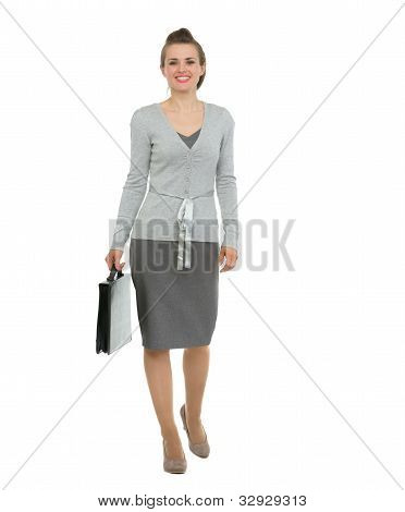Modern Business Woman With Briefcase Making Step Forward