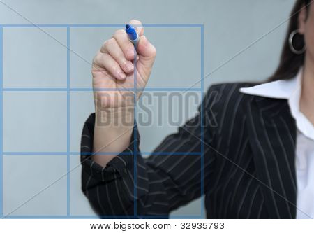 Businesswoman Drawing A Blue Graph Chart