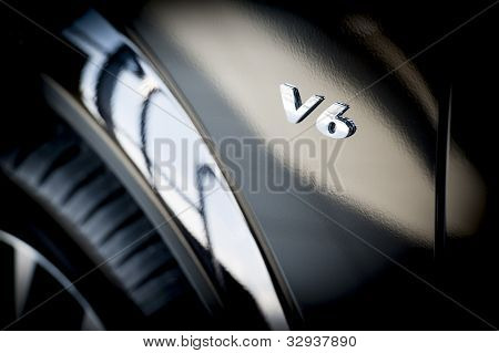 V6 Emblem on side of new car