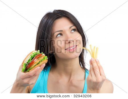 Young Woman With Burger And French Fries