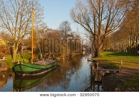 A Reed Barge In The Canal Of The Dutch Village Of Drimmelen