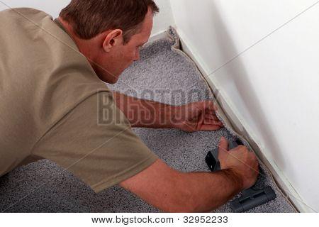 artisan laying carpet
