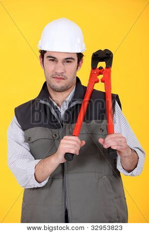 Man with pair of bolt cutters