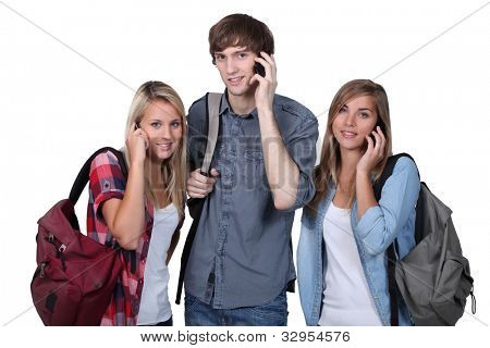 teenagers with backpacks and mobile