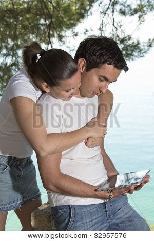 Young happy couple with new tablet