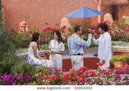 Hispanic couples drinking wine