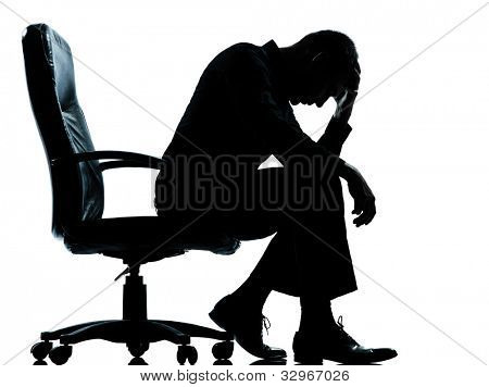 one caucasian business man tired sad despair silhouette Full length in studio isolated on white background