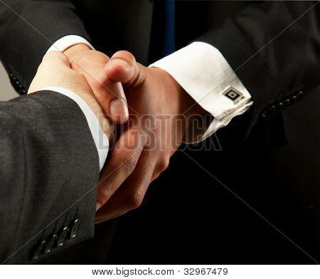 handshake isolated on black background