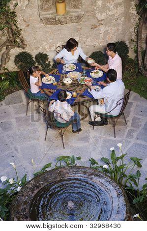 Hispanic family eating at outdoor restaurant
