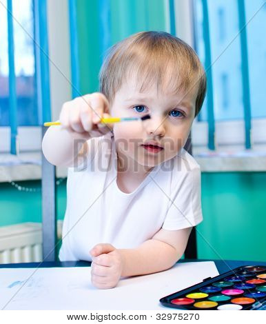 Cute Kid Painting With Watercolors