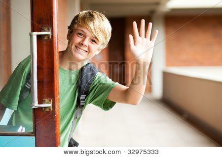 cute high school boy waving good bye