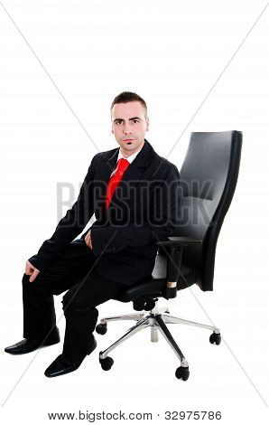 Young Businessman Sitting In Office Leather Armchair