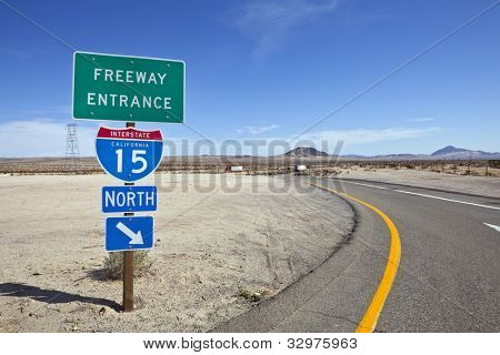Mojave desert freeway and interstate 15 sign near Baker California.