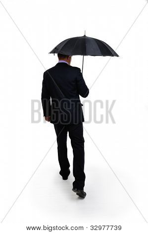 Business man in elegant modern suit holding an umbrella standing back