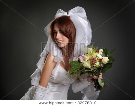 beautiful young bride on dark background