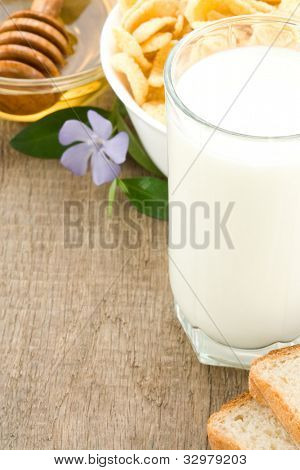 milk products isolated on wood background