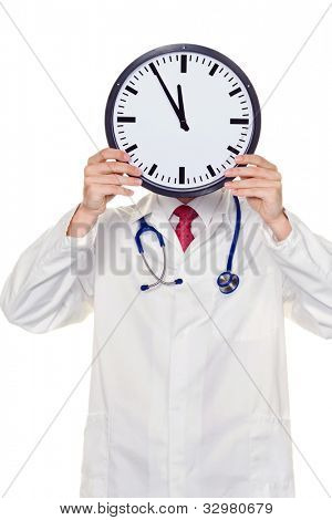 a doctor in the head before clock with stress. working in kranklenhaus.