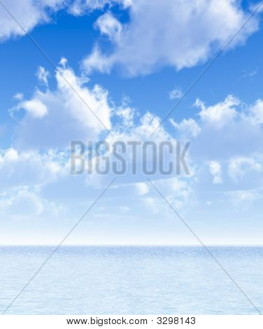 Sea And Sky With White Fluffy Clouds