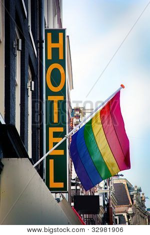 Hotel with The Rainbow Flag - symbol of homosexual, bisexual, and transgender. Amsterdam, Netherlands