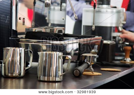 Professional coffee machine closeup with selective focus