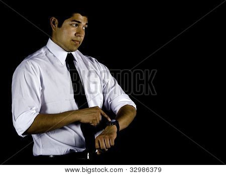Man in white shirt points to his watch