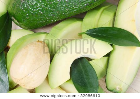 Cut fresh avocado with leaves close up