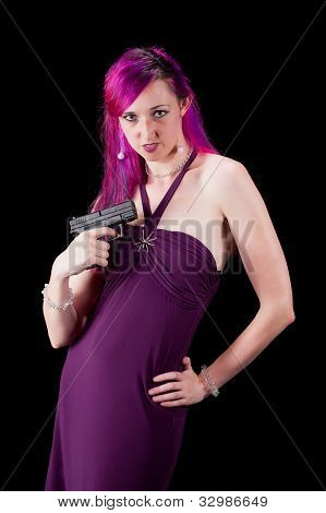 Woman posing with a gun.