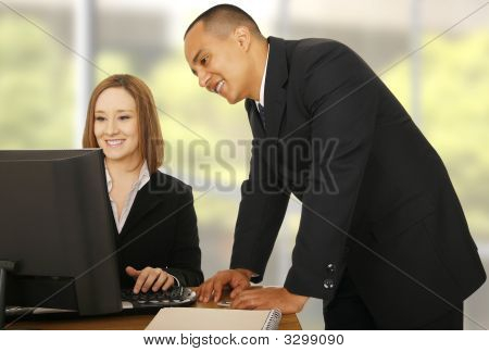 Business Team Looking At Compiter