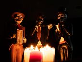 Three Dead Skeleton Musician Playing In The Darkness With Red White Candles Halloween Day Of Dead poster
