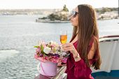Cruise Ship Vacation, Girl Enjoying Sunset On Sea Cruise. Elegant Happy Woman In Sunglasses, She Is  poster