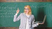 Educator Smart Clever Lady With Modern Laptop Searching Information Chalkboard Background. Online Sc poster