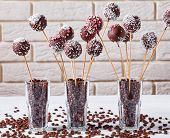 Homemade Chocolate Cake Pops Sprinkled With Crushed Candies And Coconut Sprinkles In Three Glasses W poster