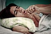 image of cough  - Grunge and gritty portrait of sick woman laying in bed and coughing - JPG