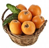 pic of loquat  - Loquat Medlar fruit in basket isolated on a white background - JPG