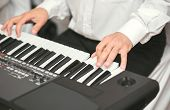 Hands Of Male Musician Playing At Synthesizer. Mens Arms Plays Solo Of Music Or New Melody. Close Up poster