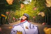 Woman With Umbrella In Park In Autumn. Autumn Vacations Lifestyle. Woman Expressing Happiness .vacat poster