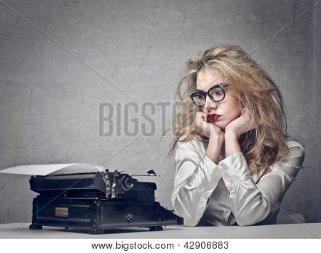 beautiful journalist looks typewriter