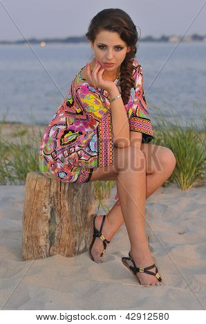 Beautiful brunette model posing pretty at tropical beach