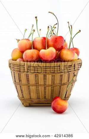 Rainier Cherries In A Wooden Basket